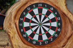 Dartboard on wooden wall. Stock Images