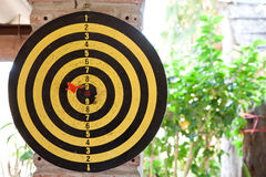 A dartboard. In Yellow and Black Stock Images