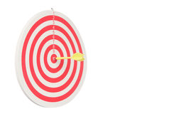 Dartboard with yellow dart at the center isolated on white Stock Image