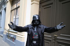 Darth Vader parody, fancy-dress. Star wars parody. Man in Darth Vader clothes in the on the street Royalty Free Stock Photos