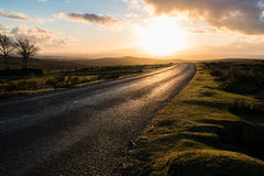 Dartmoor dusk road. Looking along a road on the Dartmoor hills in winter Stock Photography