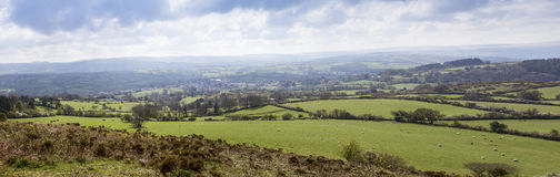 Dartmoor panorama Moretonhampstead Village. Dartmoor panorama centred on the historic village of Moretonhampstead viewed from a nearby hill with sheep and Royalty Free Stock Photography