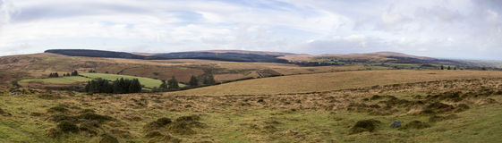 Dartmoor Panorama. Panoramic landscape view of Dartmoor looking towards the highest parts of the moor Stock Image