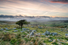 Dartmoor Sunset. A cloudy sunset over Dartmoor National Park in Devon from coombestone Tor Stock Photo