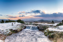 Dartmoor Waterfall. A snowy waterfall on Dartmoor National Park in Devon at Windy Post near Princetown Royalty Free Stock Images