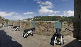 Dartmouth castle. A view of dartmouth castle cannons royalty free stock image