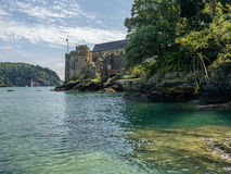 Dartmouth Castle from The Riverbank. Image of Dartmouth Castle to the end of the Estuary. Flag flying stock photography