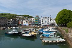 Dartmouth Devon inner harbour in beautiful spring weather. Beautiful sunshine and calm weather drew sailors and visitors to the coast at Dartmouth, Devon on stock photos
