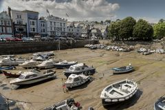Dartmouth Harbour Devon UK. Really a basin for small boats and pleasure craft accessible when the tide is in as it is on a tidal part of the river Dart stock images