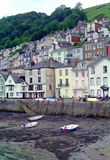 Dartmouth Waterfront Devon England. Homes crowd a hillside along the seawall in Dartmouth harbour, Devon, United Kingdom royalty free stock image