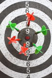 Darts. Target with six green and red dart Royalty Free Stock Photo