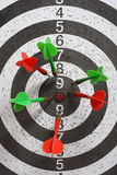 Darts. Target with six green and red dart Stock Images