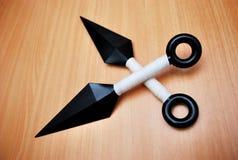 Darts. A pair of flying daggers replica used by ninjas (japanese assassins). Plastic 'Kunai Stock Photo