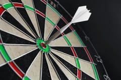 Darts. Dart and the board hitten in ten Stock Photo
