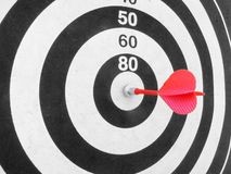 Darts. Red dart in a bull's eye Royalty Free Stock Photo
