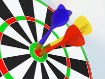 Darts. Arrows have got to the target centre Stock Photography
