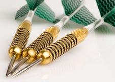 Darts. Close up of darts with green flight Royalty Free Stock Photo