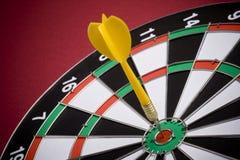 Darts. Dart in center of target Royalty Free Stock Image