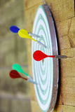 Darts. Colorful darts on the dartboard royalty free stock photos