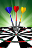 Darts. With arrow over green backgrounds Stock Image