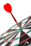 Darts. With red arrow over white Stock Photo