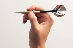 Darts. Hand holding dart prepare to throw royalty free stock images