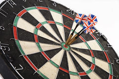 Darts. Centre dartboard darts entertainment fun game hit lunge mark on point put rush score spike spurt target throw win winning Royalty Free Stock Image