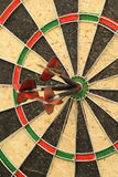 Darts. 3 darts in the center of a target Royalty Free Stock Photography