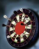 Darts all miss the Big Bull's Eye. Royalty Free Stock Photo