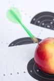 Darts in apple Stock Image