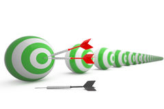 Darts on an archery target Stock Photography
