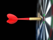 Darts arrow in bull's-eye Stock Image