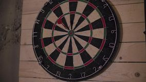 Darts arrow missing the target on a dart board during the game. stock footage