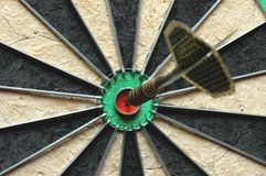 Darts arrow in the target. Darts board with single arrow in bullseye Stock Images