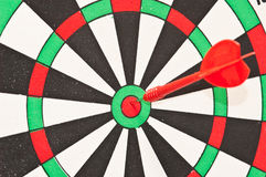darts arrow in the target center Royalty Free Stock Photos