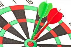darts arrow in the target center Stock Photo