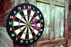 Darts with arrows. The darts with arrows hangs on an old shed Royalty Free Stock Photos