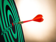 Darts arrows in the target. Board Royalty Free Stock Photography