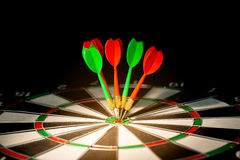 Darts arrows. In the target center Royalty Free Stock Image
