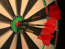 Darts arrows in the target center Royalty Free Stock Images