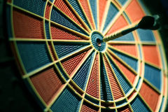 Darts arrows in the target center. stock images