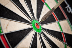 Darts arrows in the target center Stock Photography