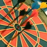 Darts arrows in the target center. Selective focus Royalty Free Stock Photos