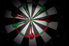 Darts arrows in the target center. Smart goal setting, dart hit royalty free stock photography