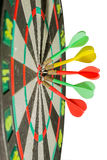 Darts arrows in the target center on a white background Royalty Free Stock Photos