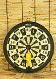Darts on a bamboo  wall Royalty Free Stock Photography