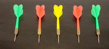 Darts. On the black background. 5 pieces Stock Image