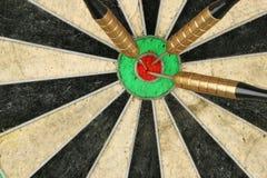 Darts in board Stock Photo