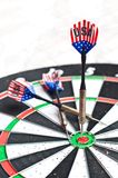 Darts on board Stock Photos