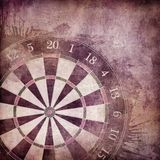 Darts Board. In Old Paper Textured Background Royalty Free Stock Photography